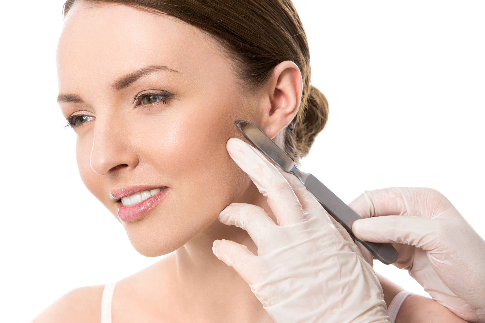 Plastic surgery. Beautiful woman on a white background
